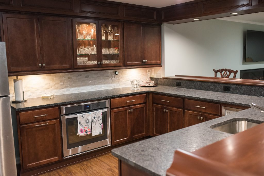 basement kitchen with pub style wood working and posts