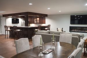 classical basement with vinyl plank flooring
