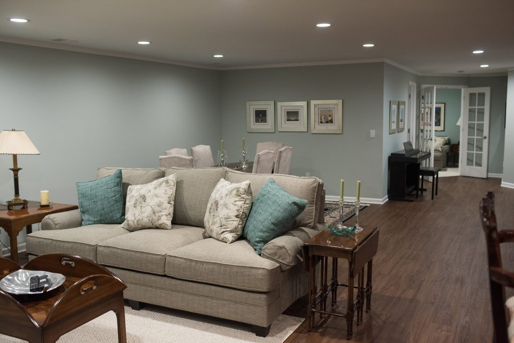 living room and formal dining area in basement