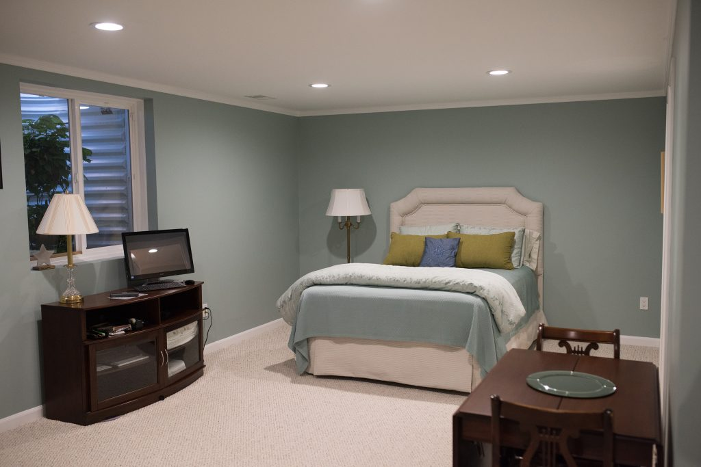 Spare bedroom in basement with egress window and bathroom in Gross Point, Michigan