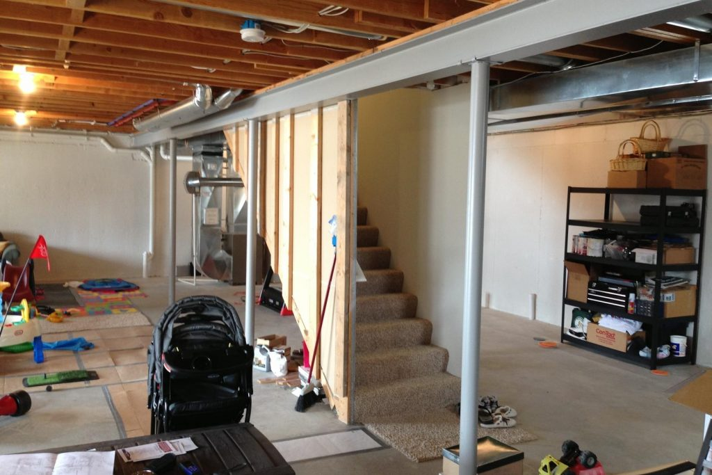 unfinished basement with staircase in the middle