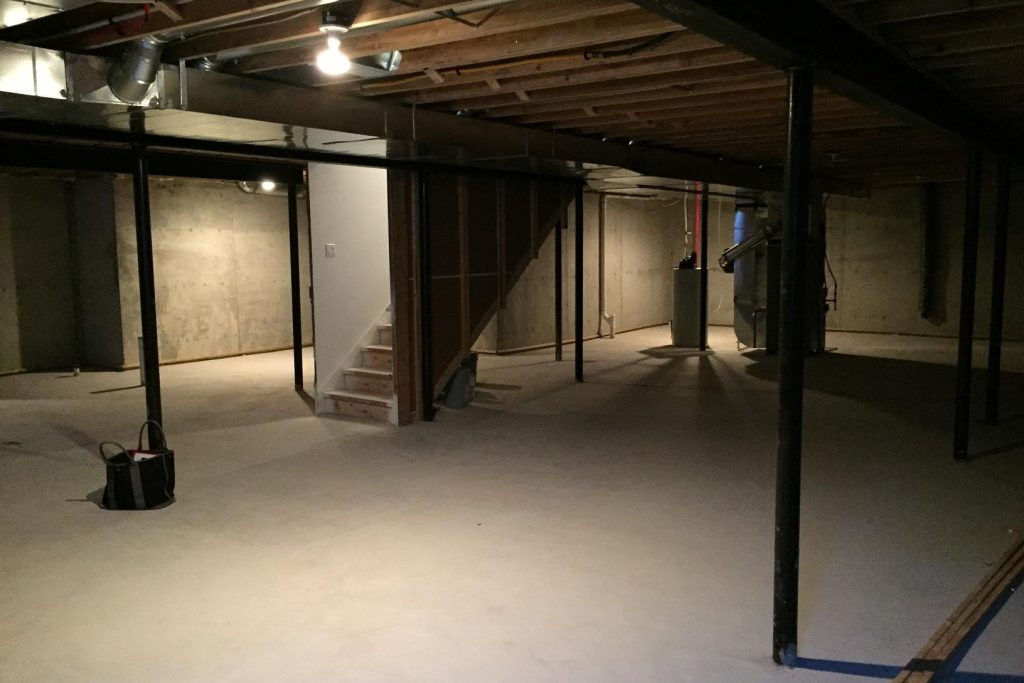 dark unfinished basement with lots of posts