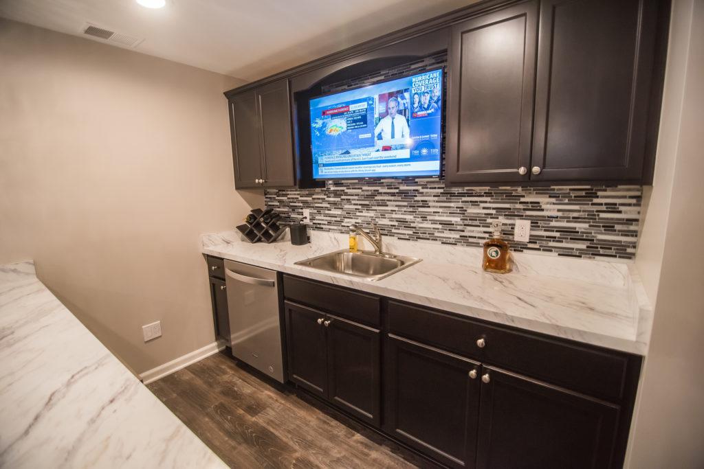 basement bar macomb with dark cabinets and laminate countertop