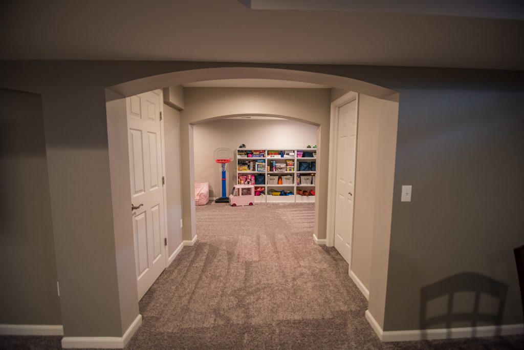 archway in basement design to playroom