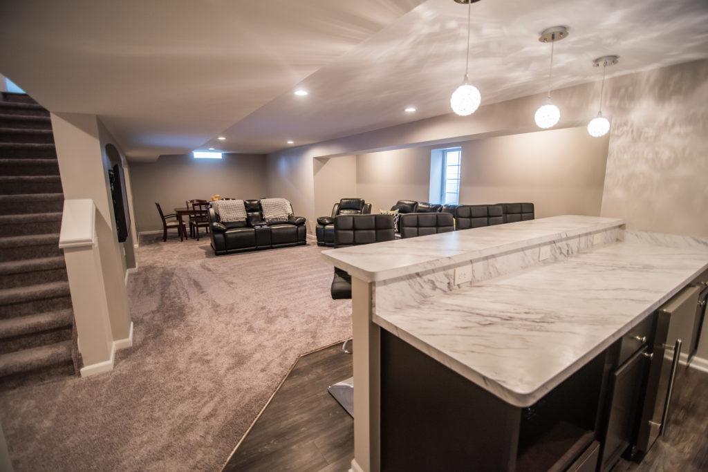 bar area overlooking living room basement
