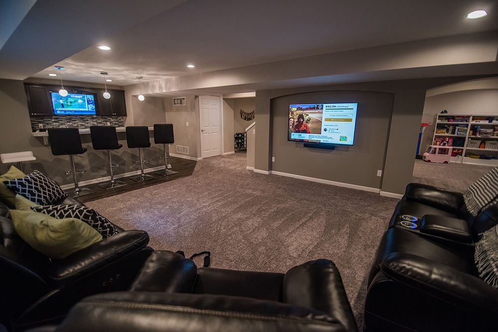 large open basement living room with carpet