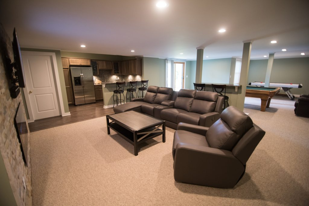 remodeled basement with open concept floorplan and living room