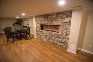 Electric fireplace within wall as design feature in Northville, Michigan