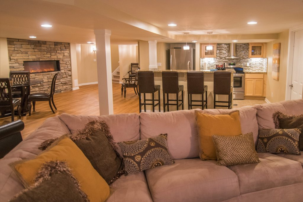 bright finished basement in northville with kitchen and fireplace