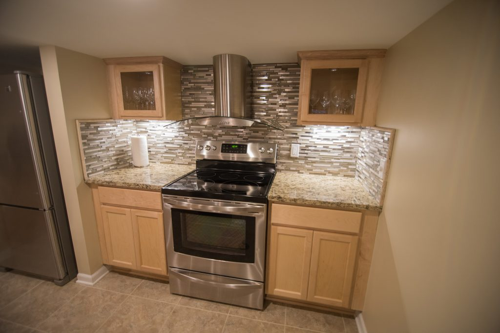 finished basement with kitchen and modern design
