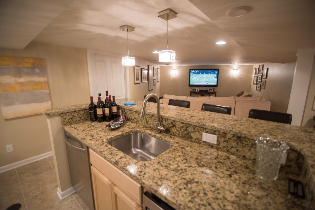 finished basement kitchen with granite countertops