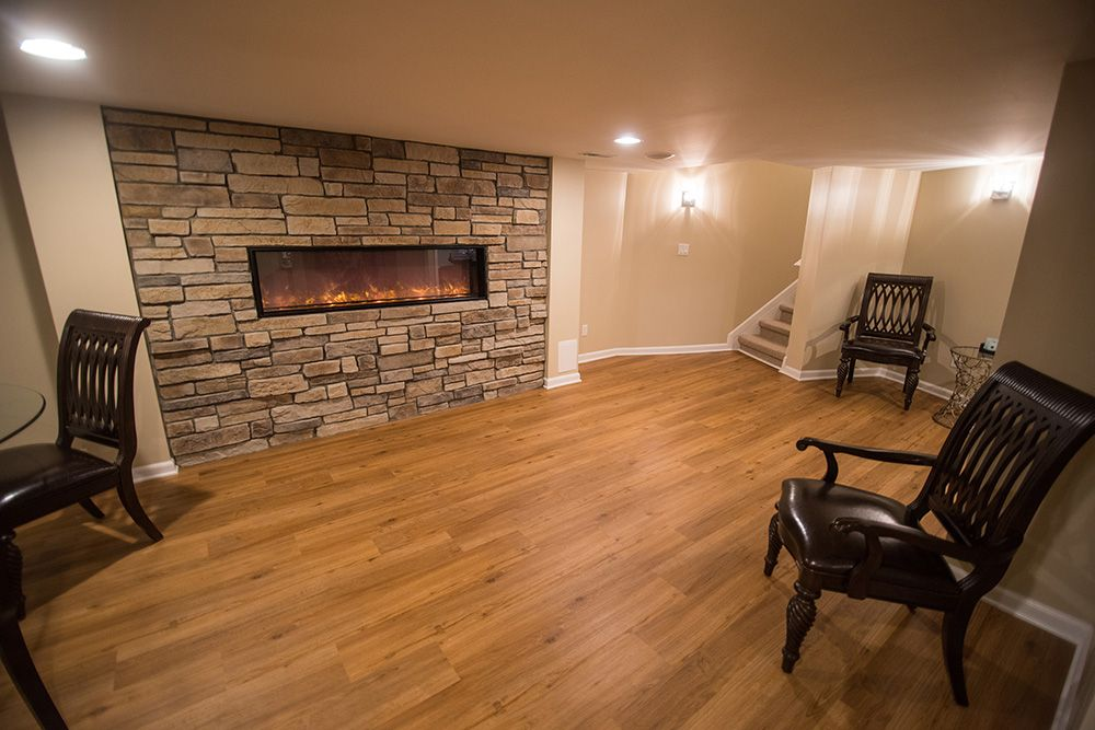 large stone fireplace on basement wall