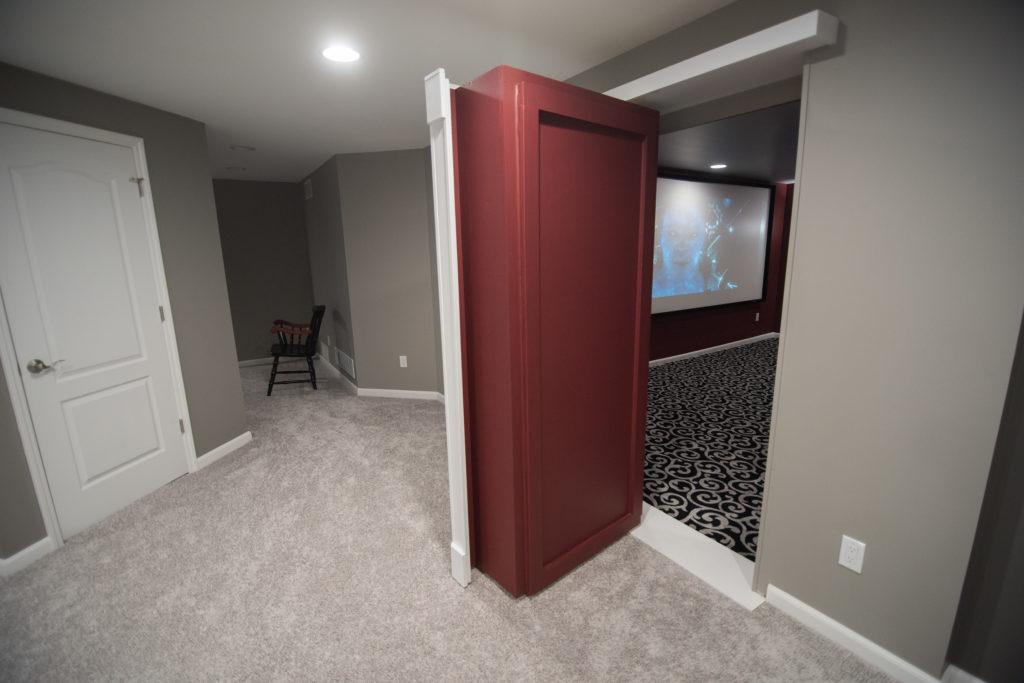 secret door leading into basement theater