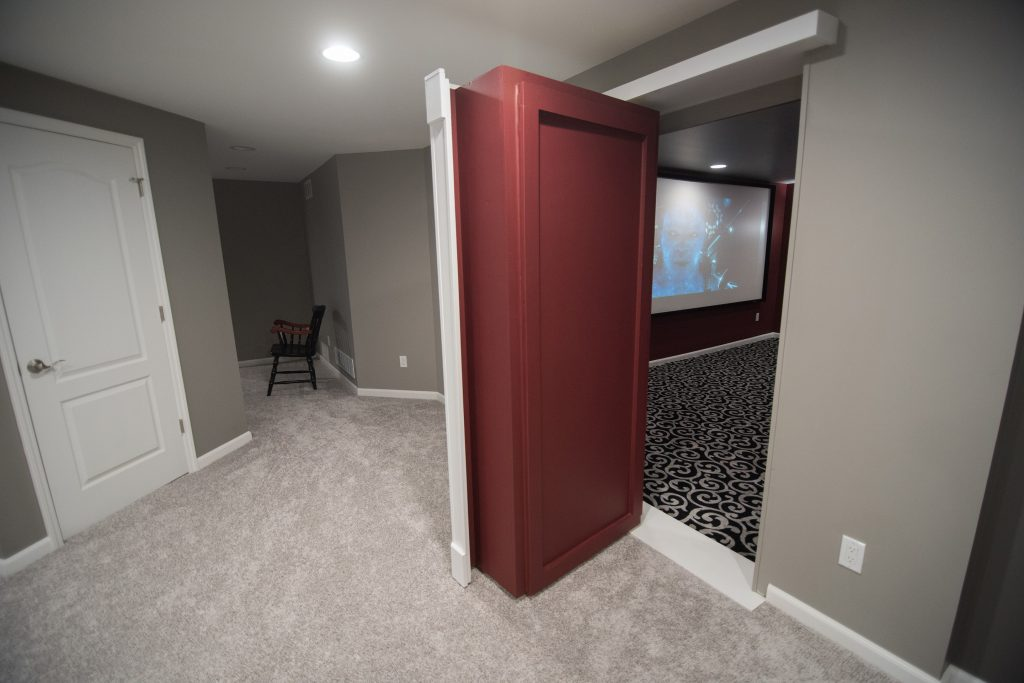 secret door leading into basement theater