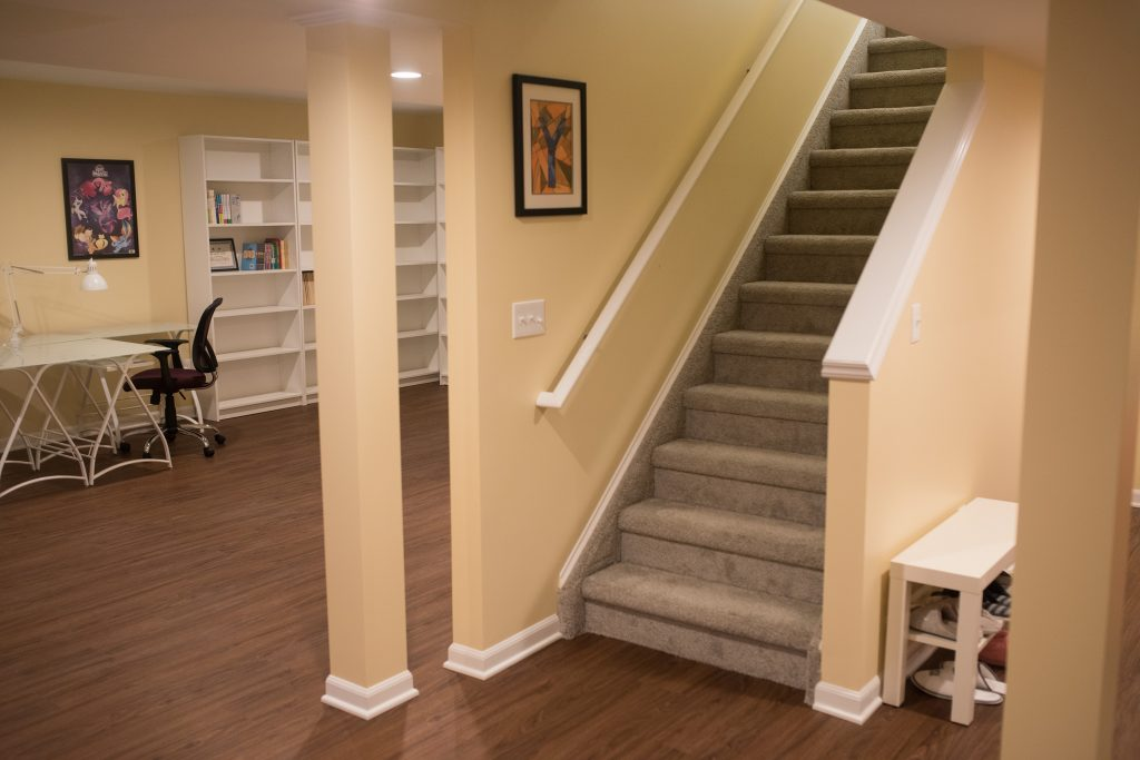 open view staircase into basement with study area behind