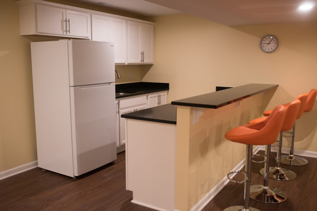 basement bar area with white cabinets
