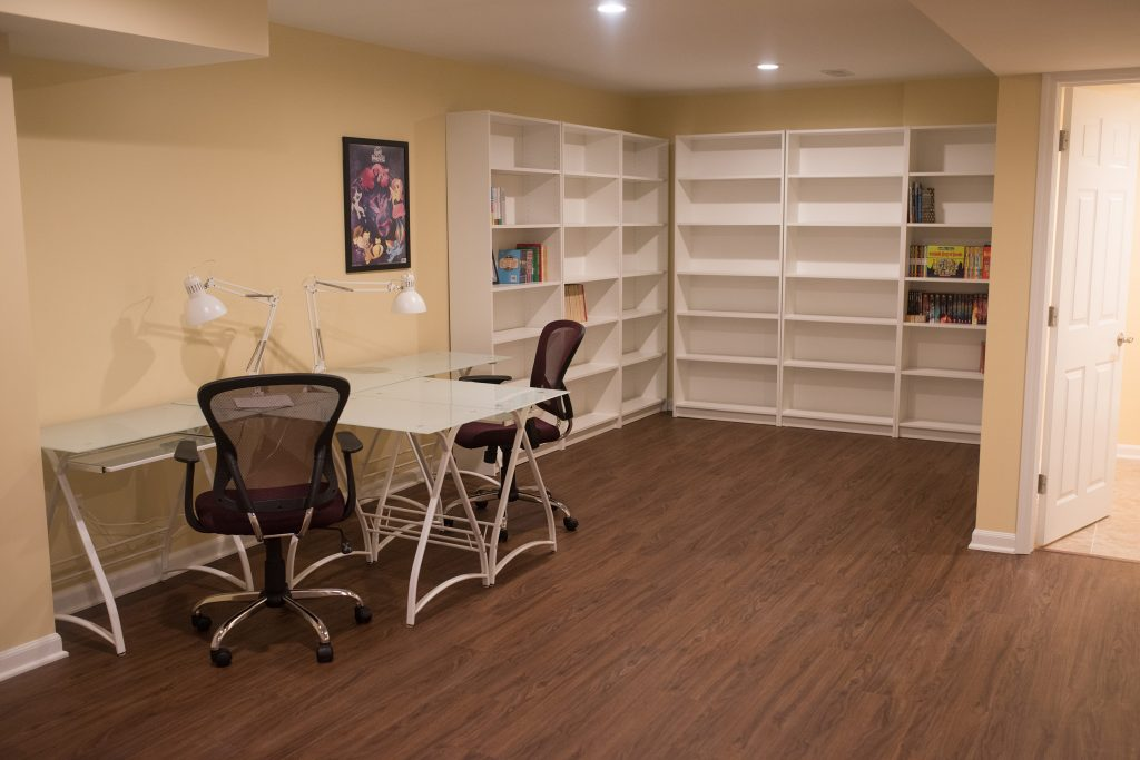 study area in basement for kids with desks and bookshelves