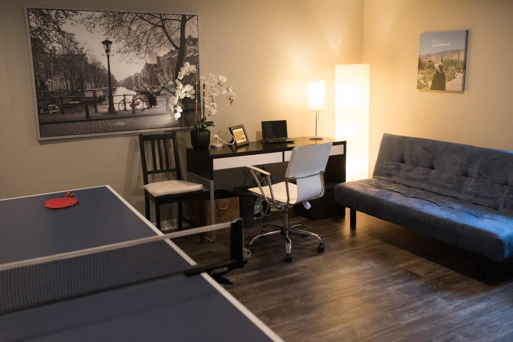small home office in basement dark vinyl plank