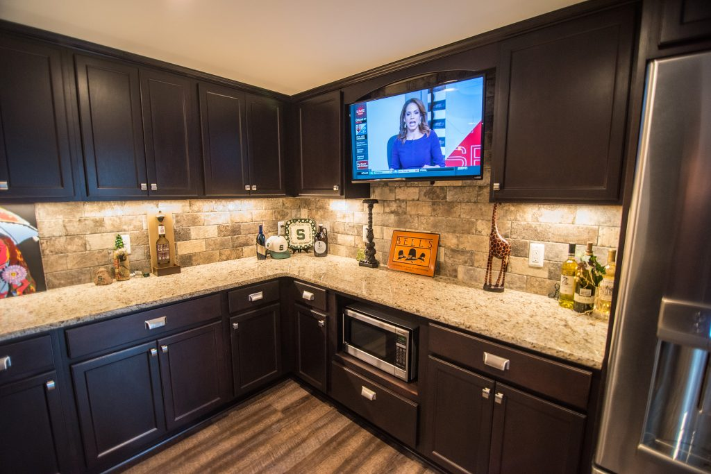 custom bar in finished basement novi dark vinyl plank granite countertops