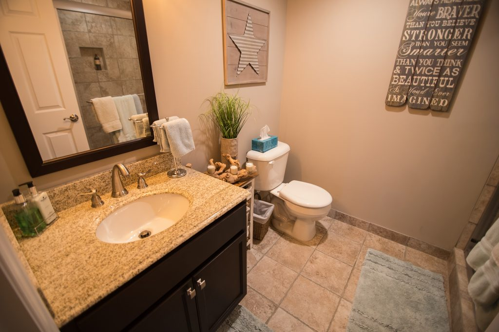 vinyl tile in basement bathroom with vanity