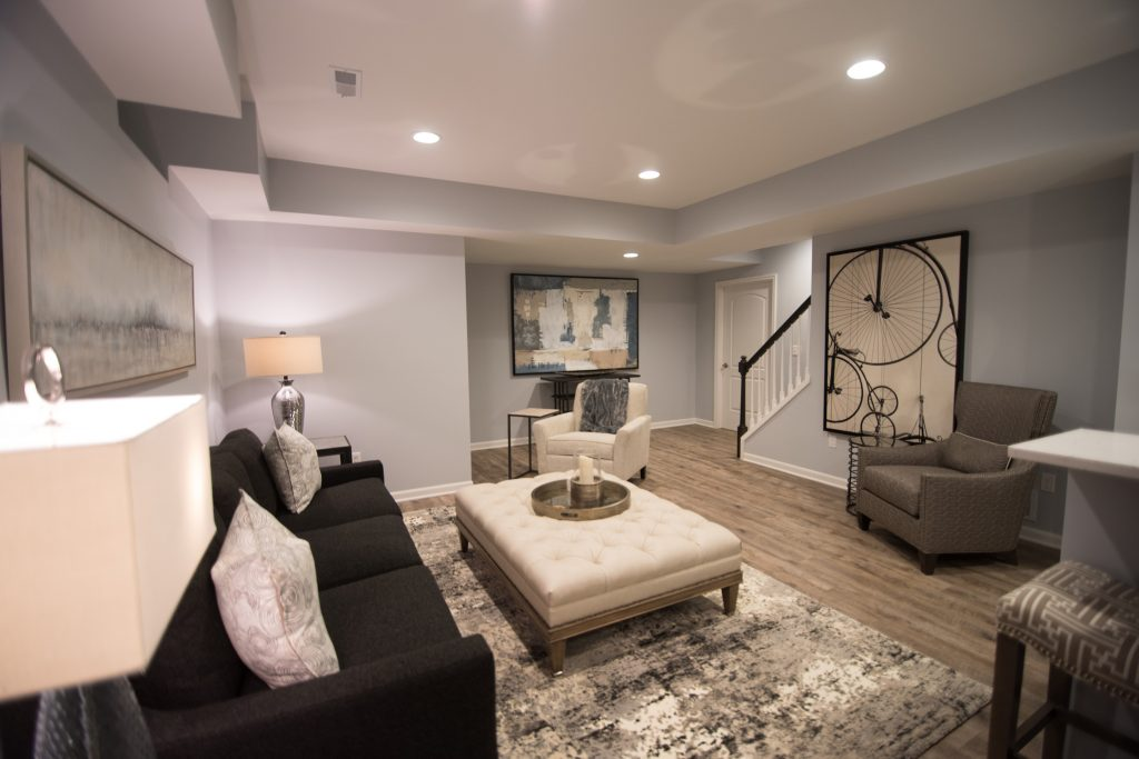 large open finished basement with vinyl plank flooring and modern design