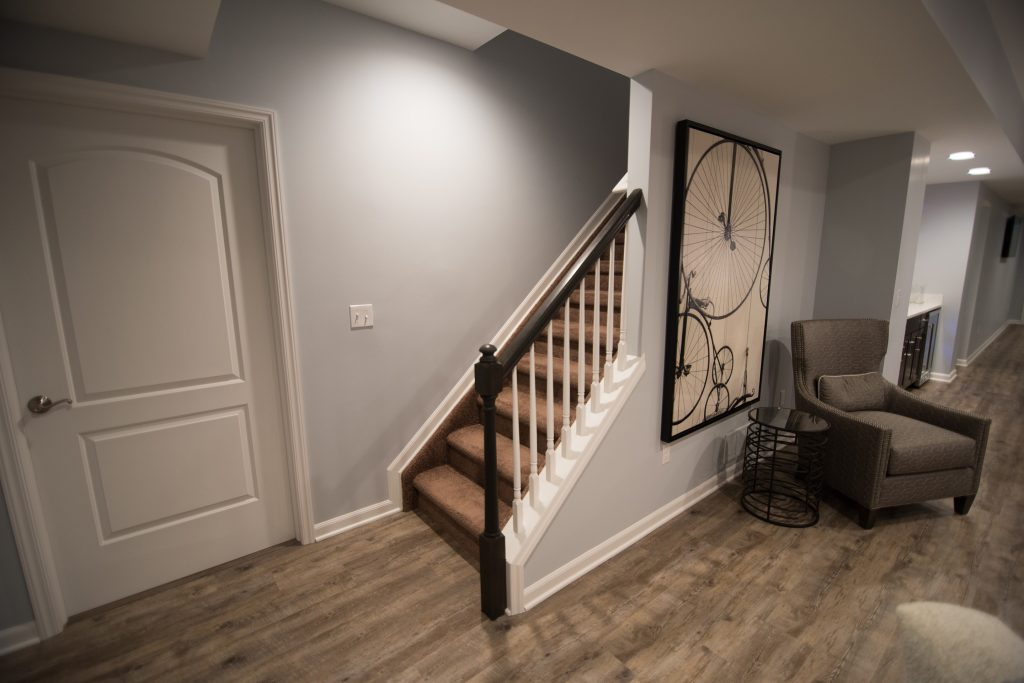 open view staircase with spindles entering basement for welcoming design
