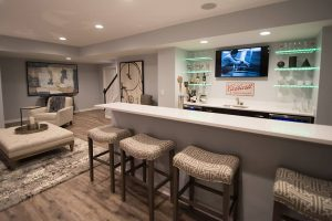 seating at the bar with led shelving and vinyl plank flooring