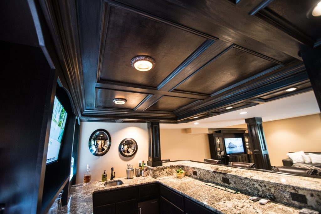 wood paneled ceiling in bar finishes off the design