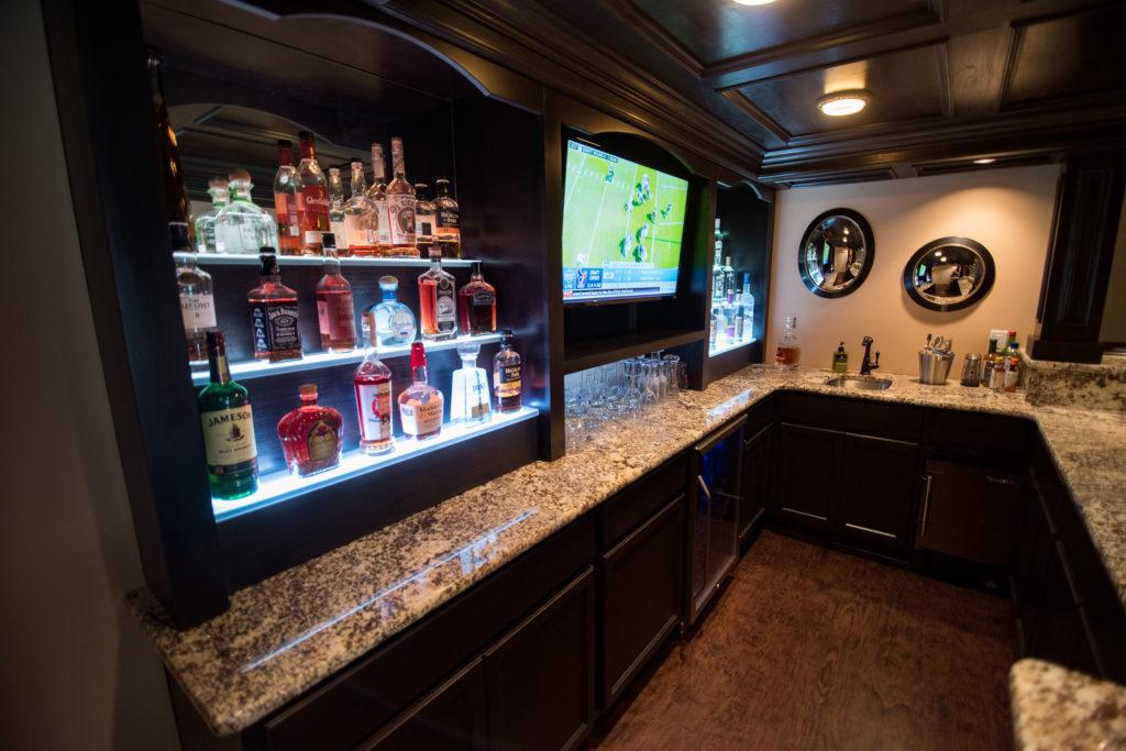 under shelf led lighting in custom home bar basement