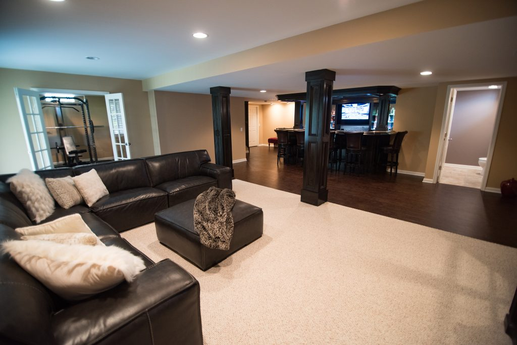 Novi Michigan finished basement with dark cabinets and living room
