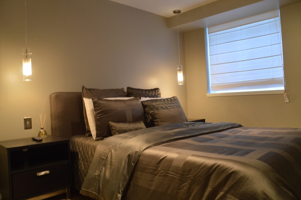 calm basement bedroom with egress window