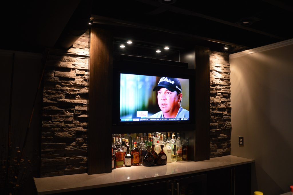stone backing on bar with wall mounted tv