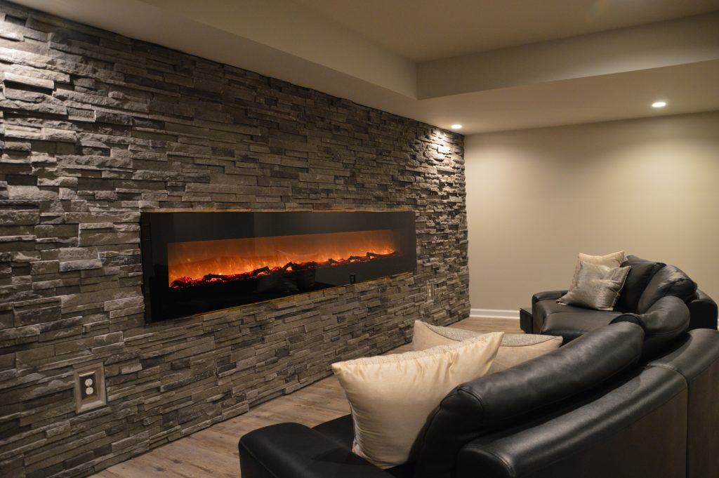 large fireplace on basement wall electric and stone