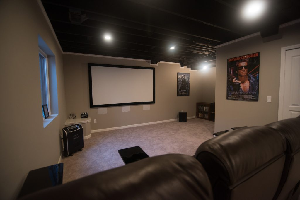home movie theater with projector carpet and painted ceiling