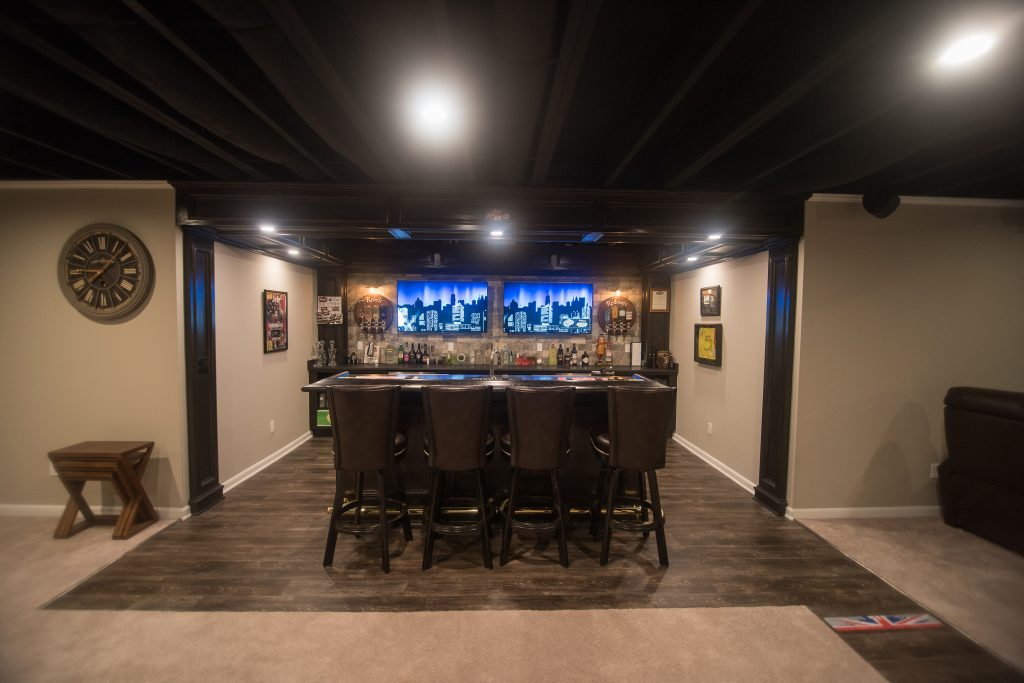 basement bar with brick walls and pub style posts