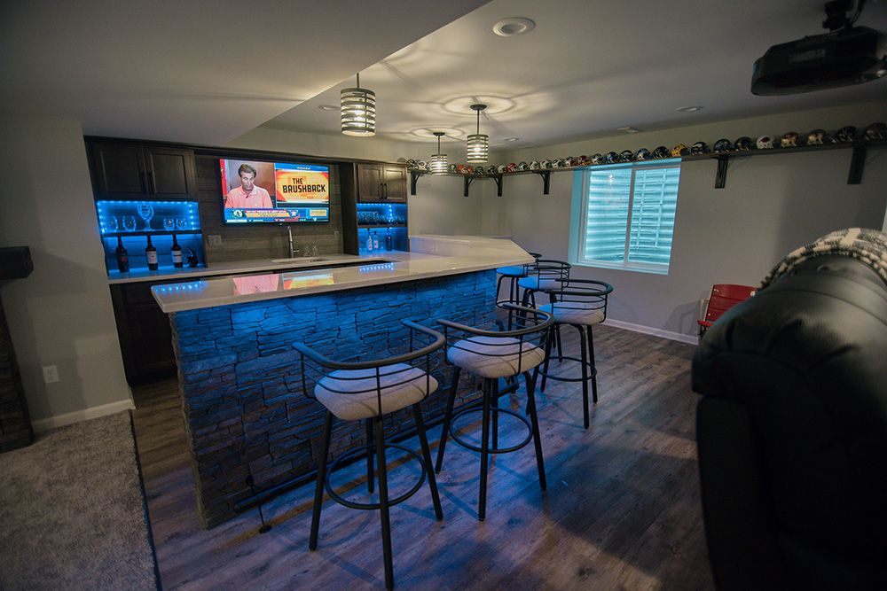 basement finished bar with led lighting and vinyl plank flooring