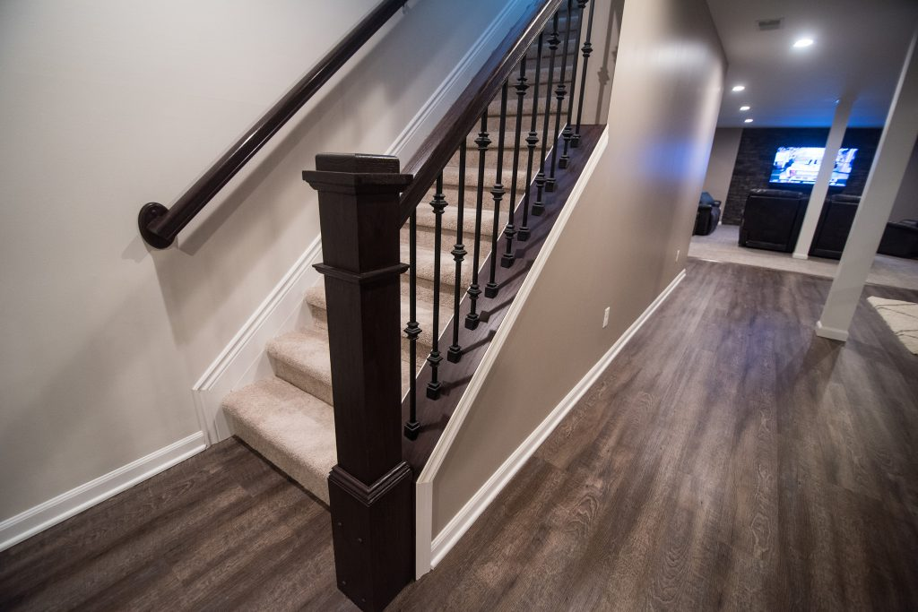 hand rail leading to basement with an open rail design