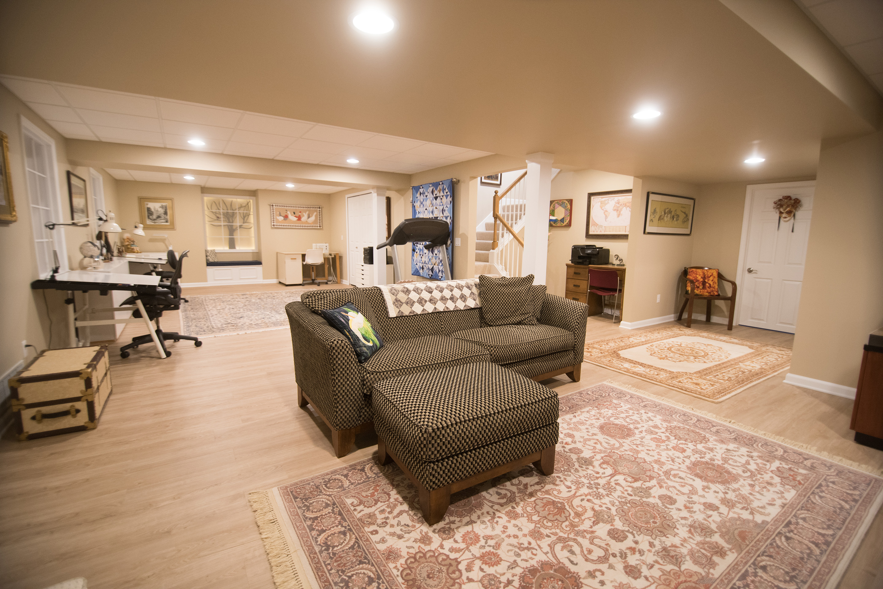 Plymouth Michigan basement living room with vinyl plank flooring and sectional couch