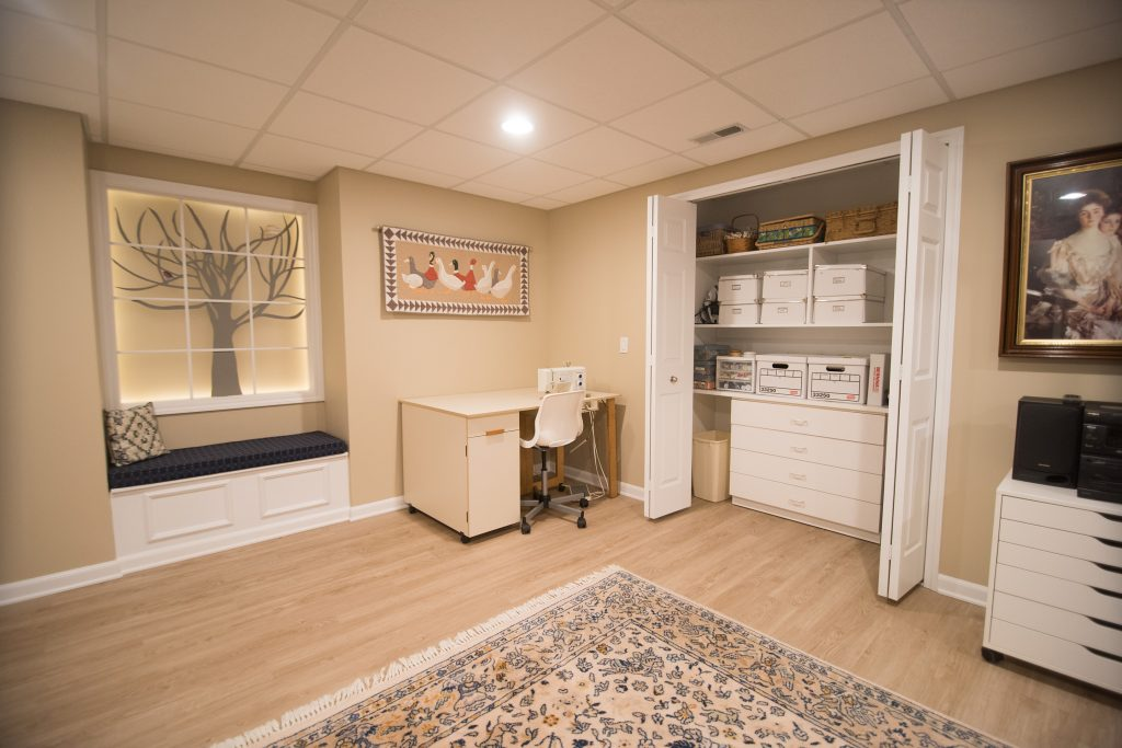 finished basement with closet and faux windows
