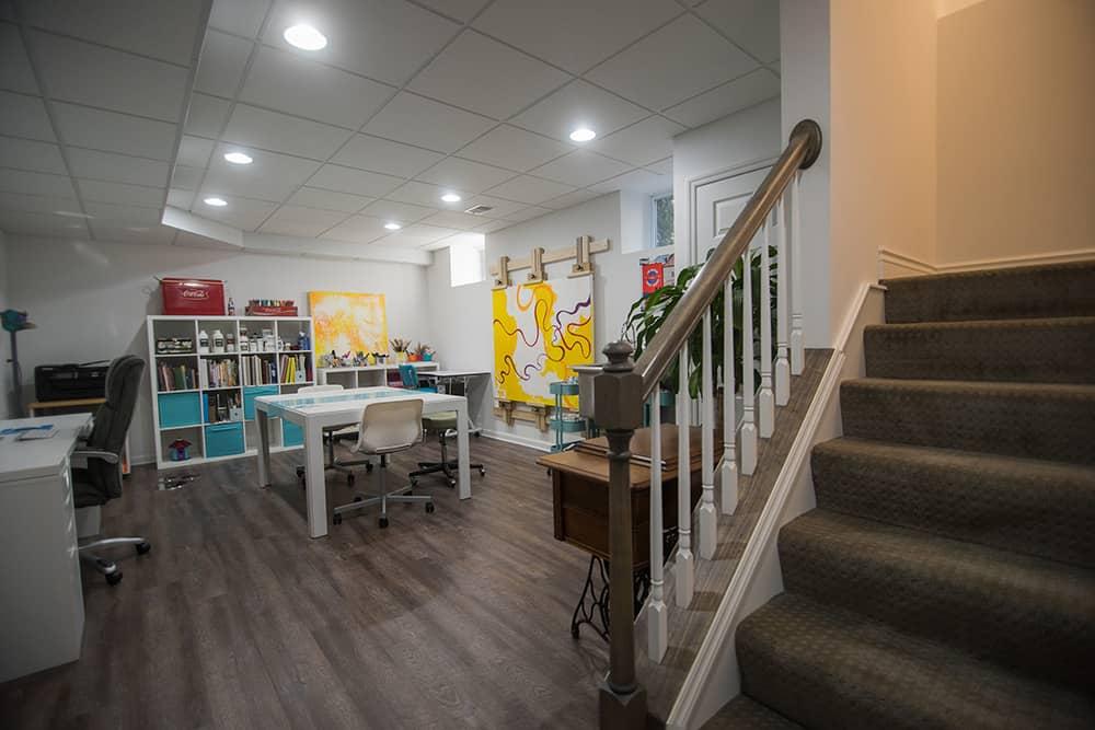 basement art studio with vinyl plank flooring and clean design