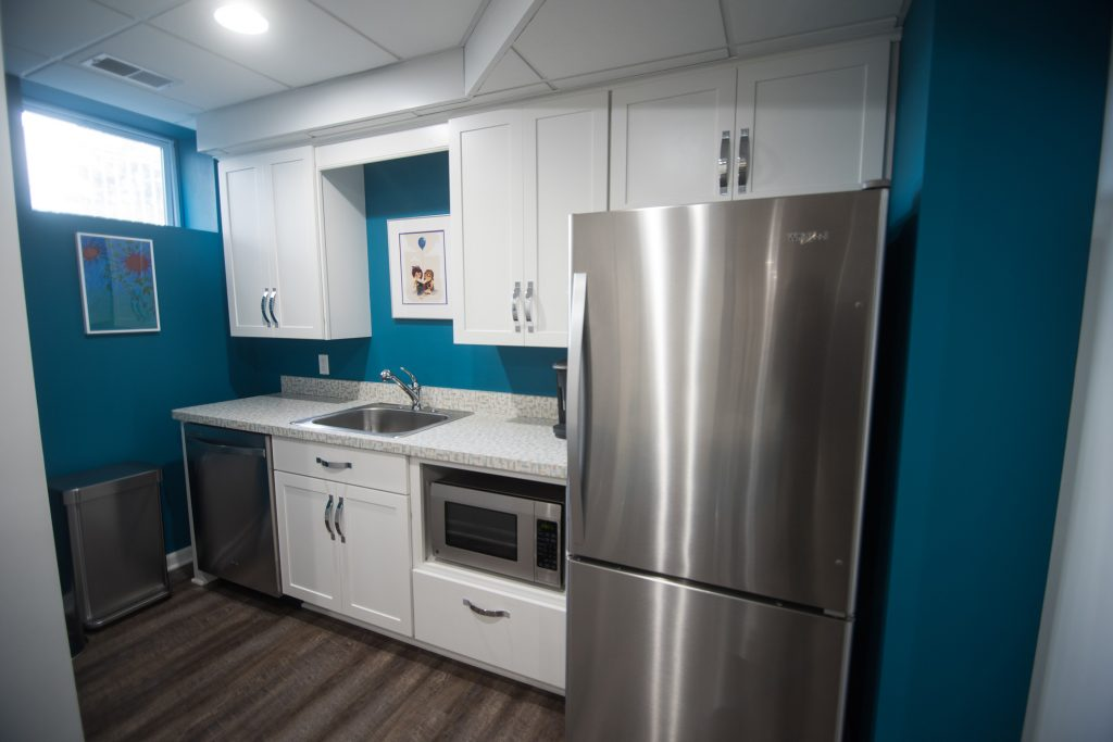 basement kitchen with shaker style cabinets