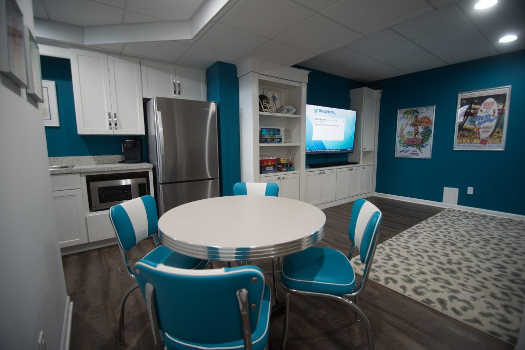 retro basement dinner table with blue accents