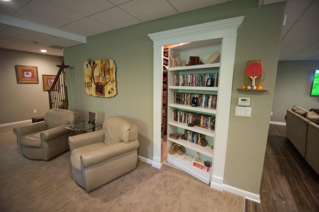 secret bookshelf door leading to furnace room in basement