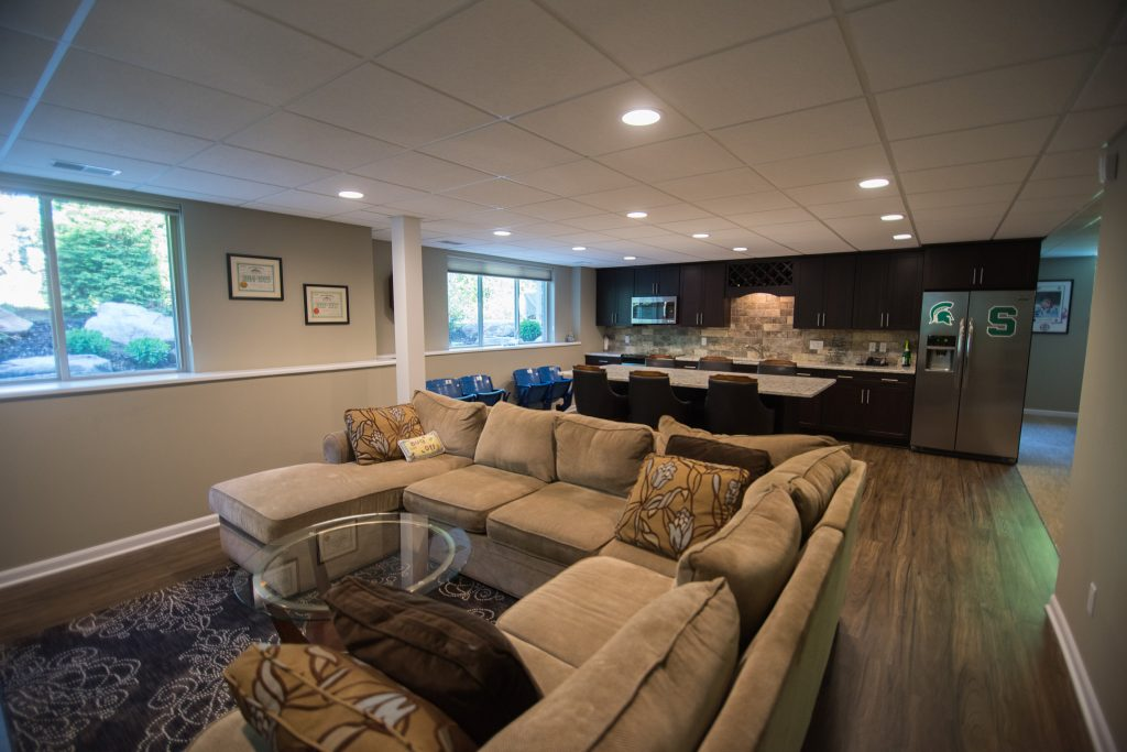 basement kitchen with adjacent living room with a large sectional