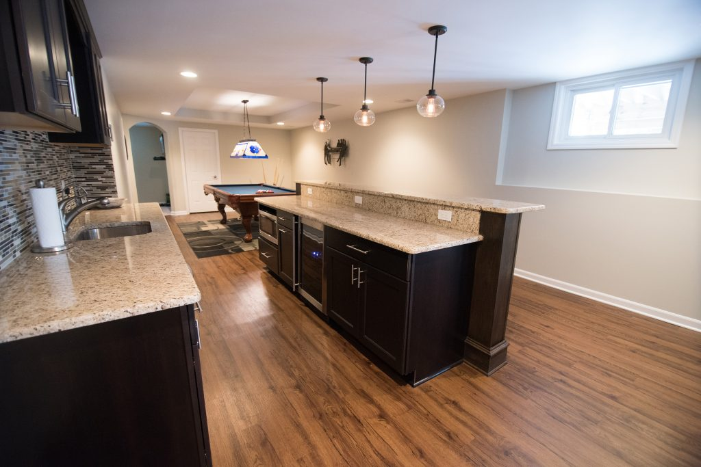 bar island in finished basement with granite countertops