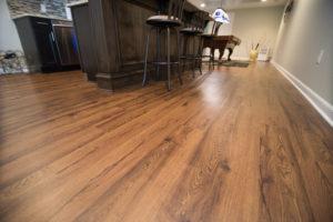 basement pub style bar with hardwood flooring