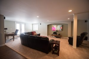 spacious cozy basement living room with carpet in lower level