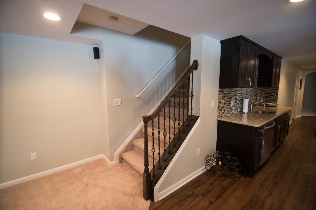 open rail staircase in basement