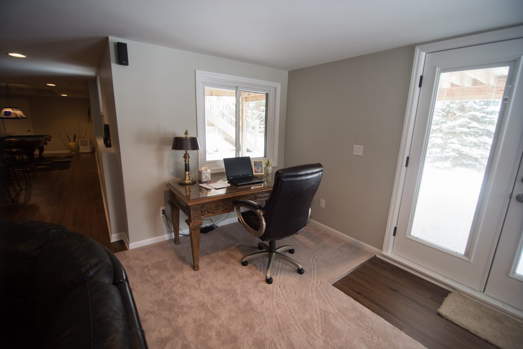 small home office area in living room of basement