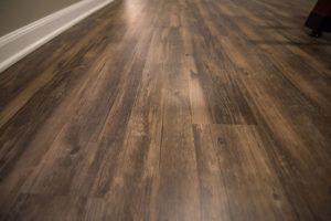 espresso colored vinyl plank basement flooring